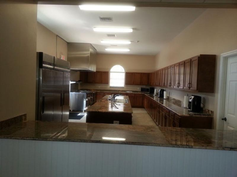 Clubhouse large kitchen with island.